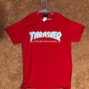 A red thrasher shirt